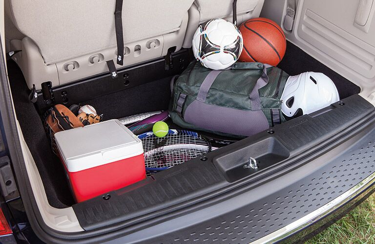 2020 Dodge Grand Caravan interior showing sports equipment in stowing area