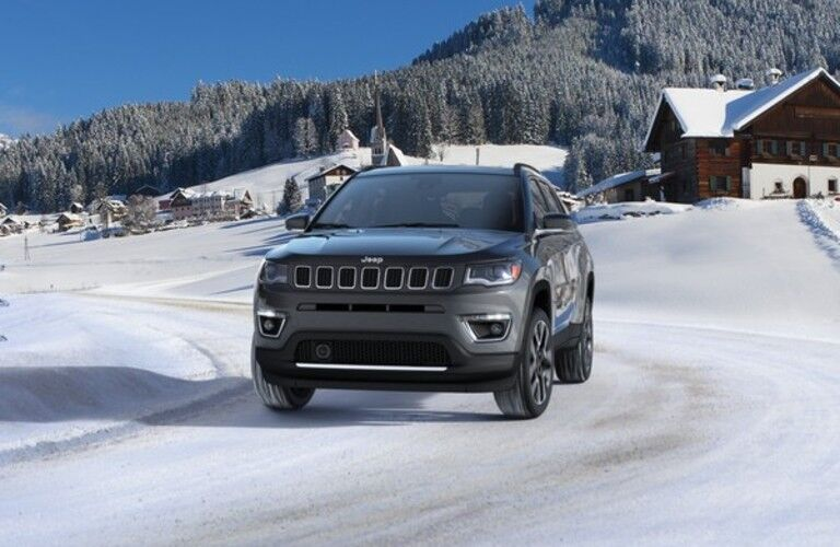 Front view of 2020 Jeep Compass driving in snow