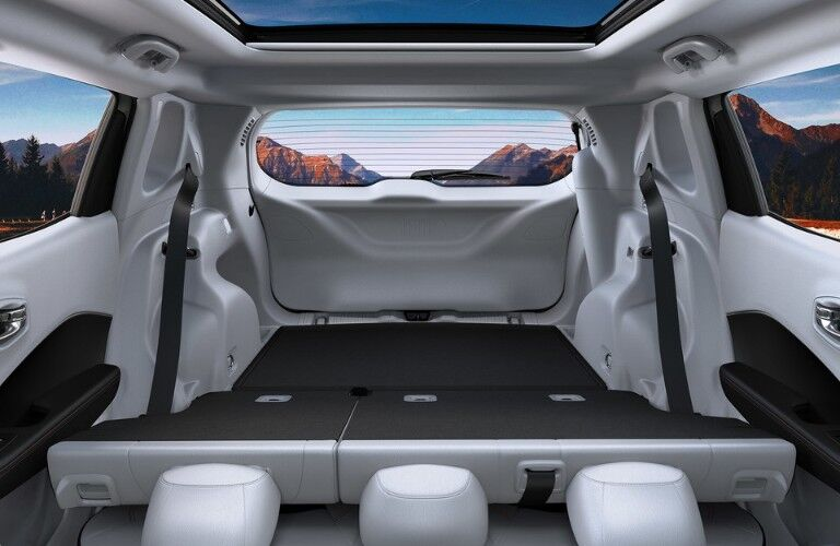 Rear rows of seats folded down inside 2020 Jeep Compass