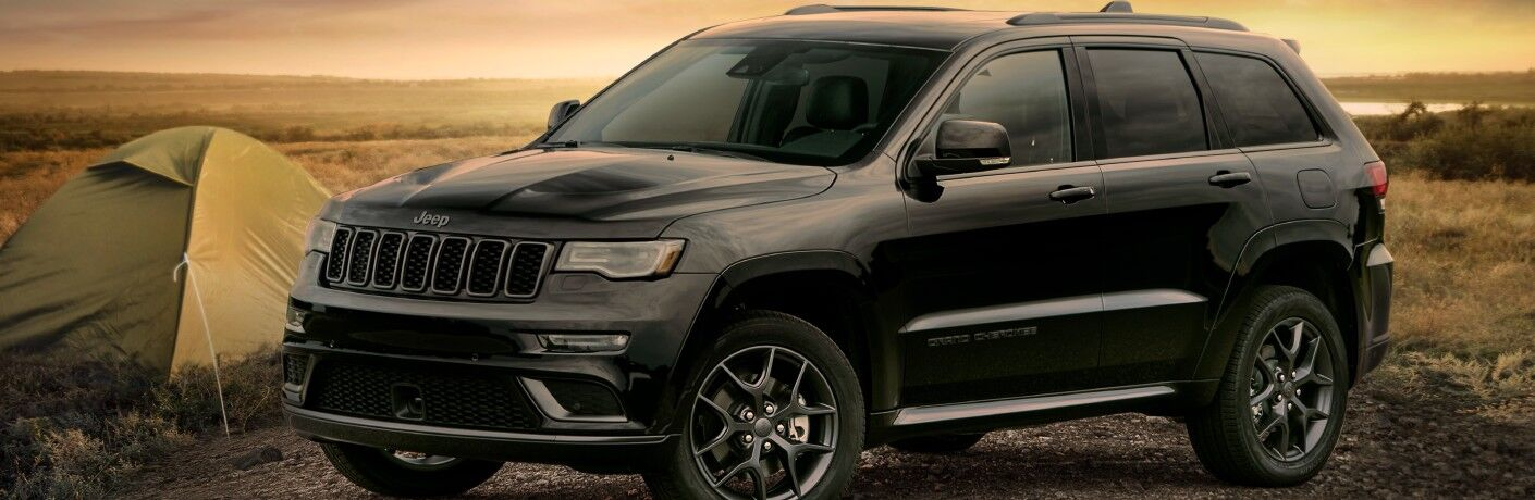 2020 Jeep Grand Cherokee Limited X black at camp site sunset