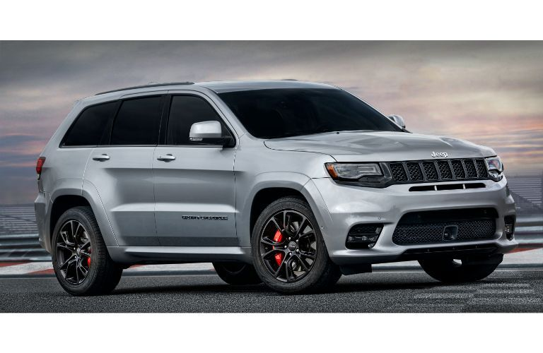 2020 Jeep Grand Cherokee SRT gray facing right at angle showing red calipers