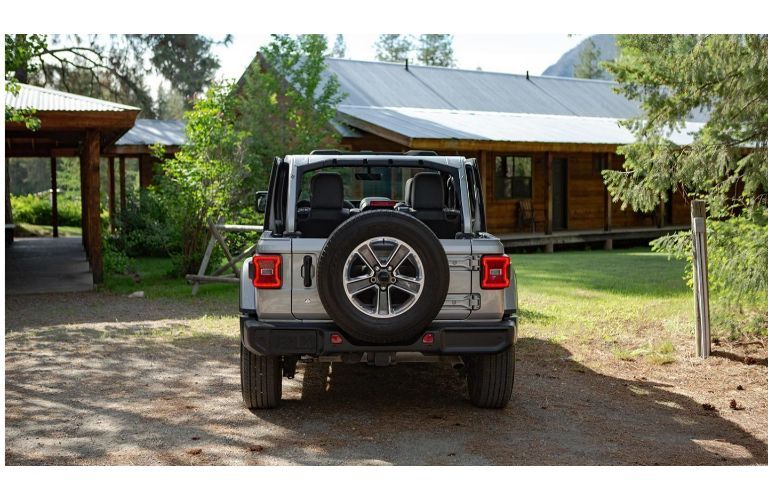 2020 Jeep Wrangler grey parked in driveway showing rear and spare tire