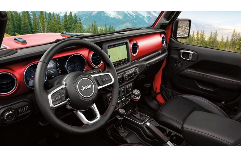 2020 Jeep Wrangler red interior shot with red dash and black wheel and seats