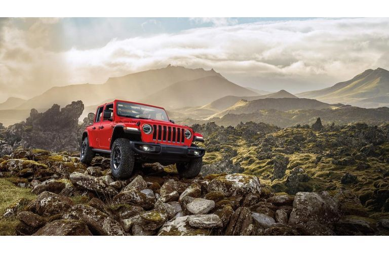 2020 Jeep Wrangler red parked high on mountain overlooking valley
