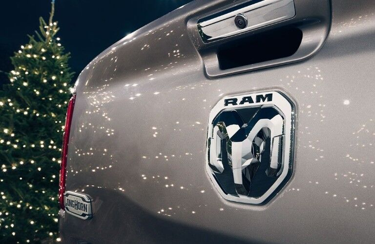 2020 Ram 1500 ram head logo on tailgate with holiday tree background