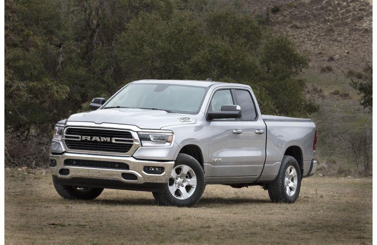 2020 RAM 1500 Big Horn exterior white parked on southwest desert sand