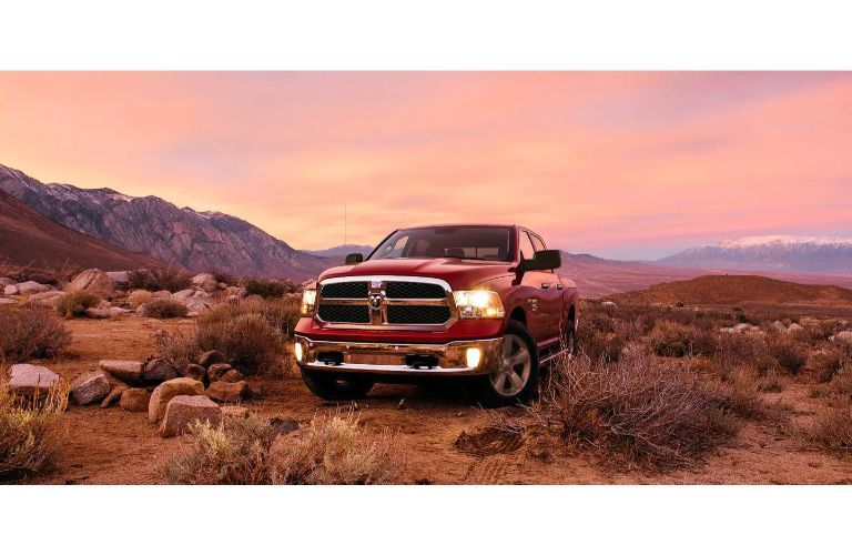 2020 RAM 1500 Classic red driving in desert orange and pink sky