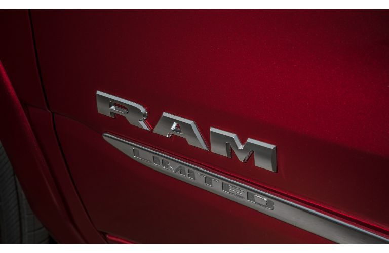 2020 RAM 1500 Limited close up of chrome logo on red exterior