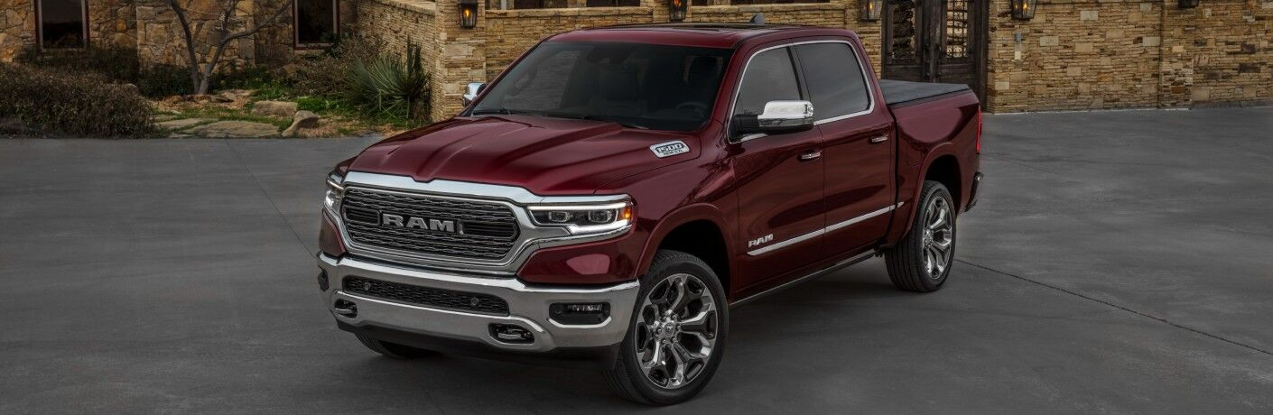2020 RAM 1500 Limited dark red parked on concrete in front of brick house