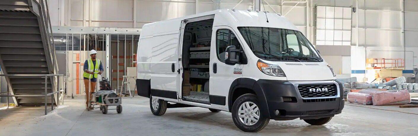 2020 RAM ProMaster Cargo Van with door open parked in warehouse near stairs