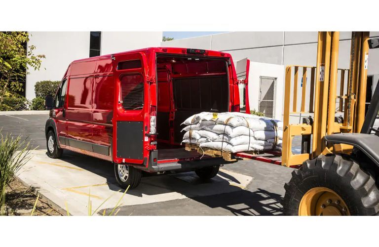 2020 RAM ProMaster Van red loading with forklift