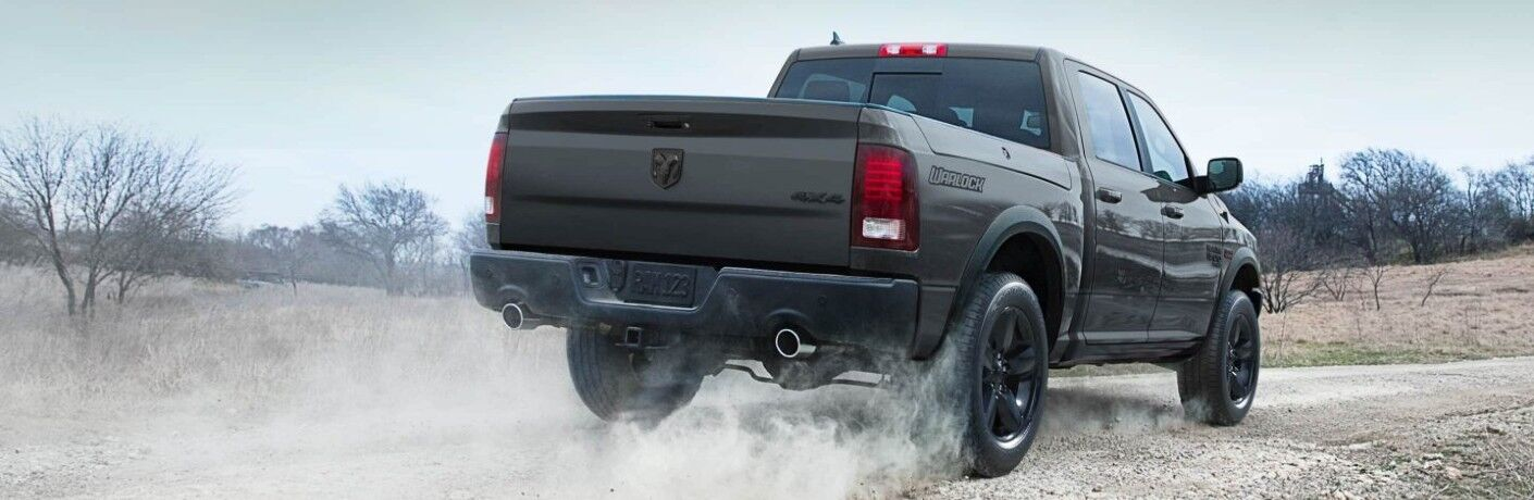 2019 Ram 1500 Classic black or grey driving on dirt kicking up dust