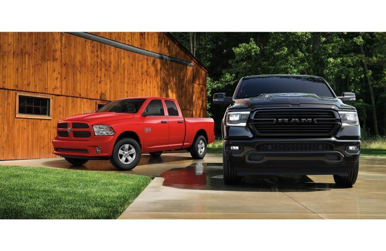 2020 Ram 1500 Classic red and black parked outside wood building on concrete
