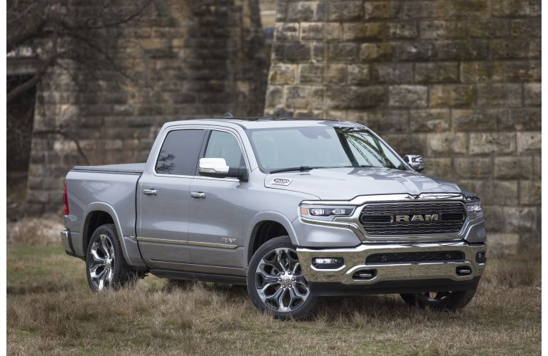2020 Ram 1500 Limited Silver parked in front of old brick building