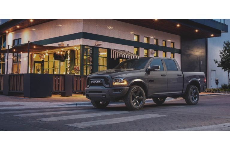 2020 Ram 1500 grey parked outside bistro with running lights on