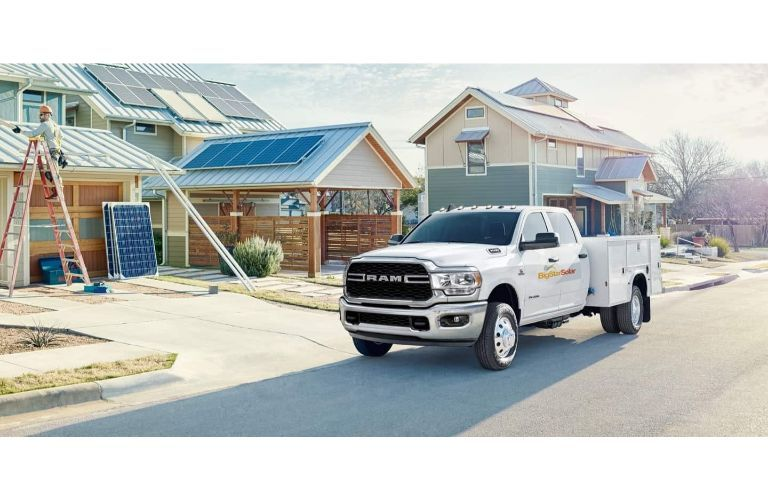 2020 Ram 5500 Chassis Cab White small business decal in front of construction site