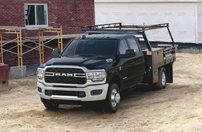 2020 Ram 5500 Chassis Cab black parked outside home construction site