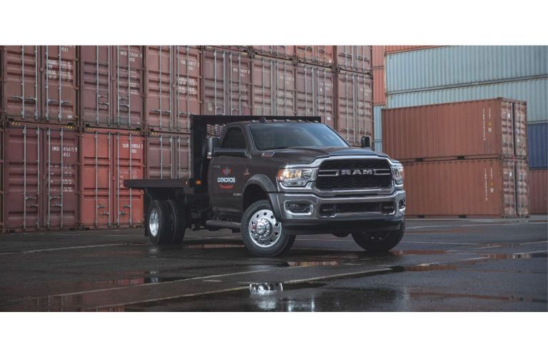 2020 Ram 5500 Chassis Cab parked in front of shopping containers
