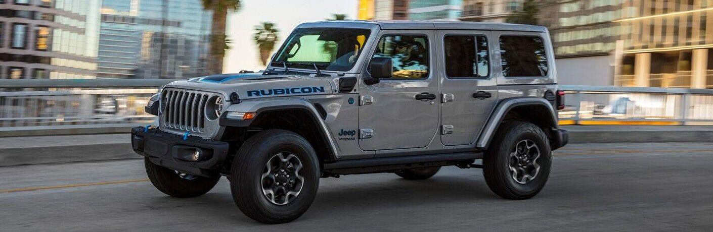 2021 Jeep Wrangler 4xe Rubicon gray driving over bridge in city