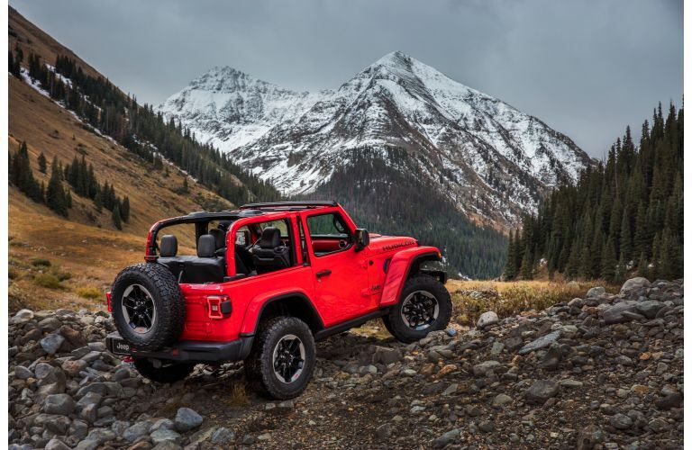 2021 Jeep Wrangler Rubicon red parked facing mountains