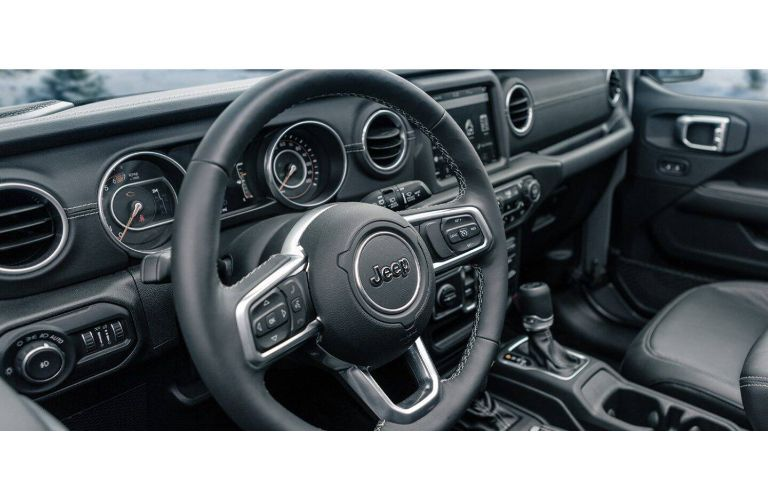 2021 Jeep Wrangler interior view of front cabin through driver side window