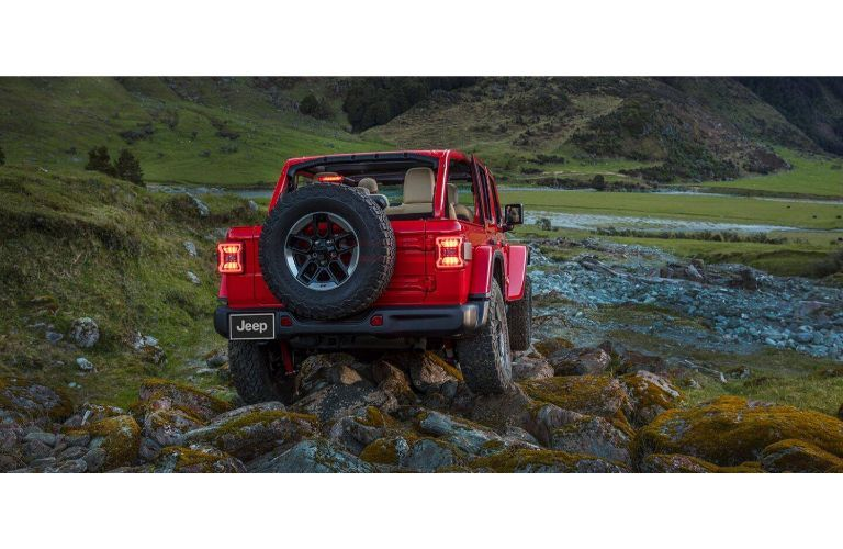 2021 Jeep Wrangler red facing away dark with tailights on