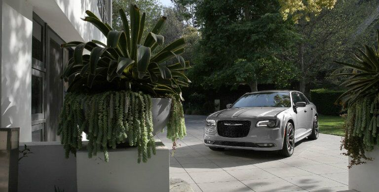 Grey 2018 Chrysler 300 pulling into the driveway