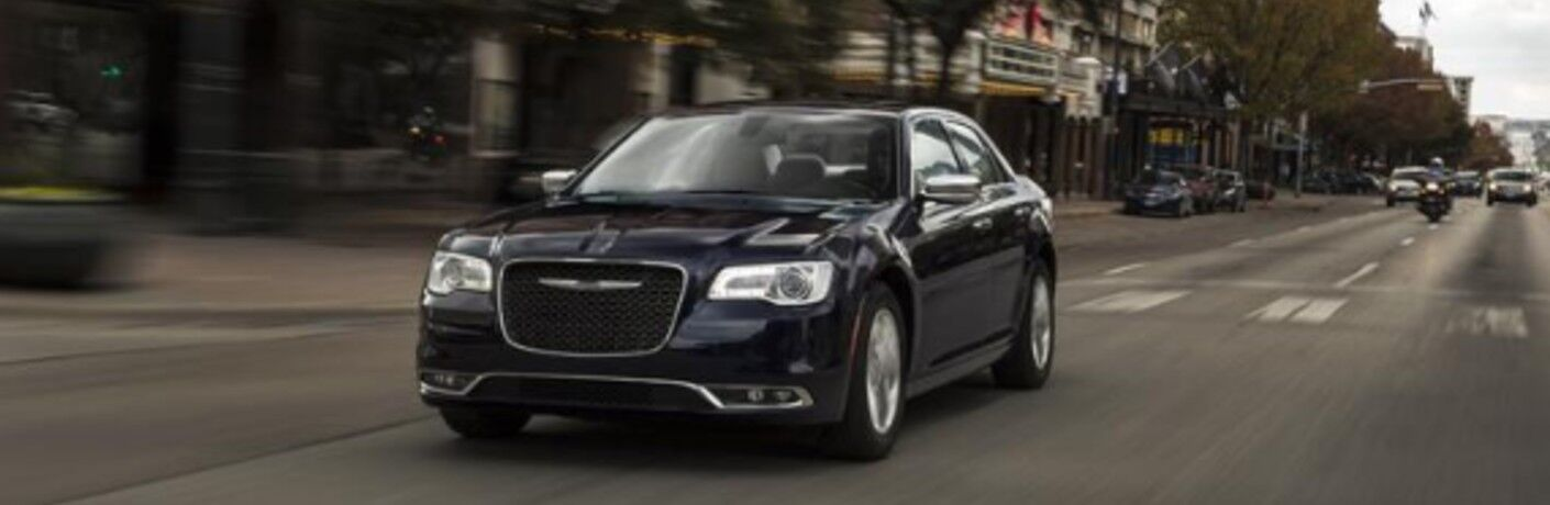 black 2020 Chrysler 300 driving down the road