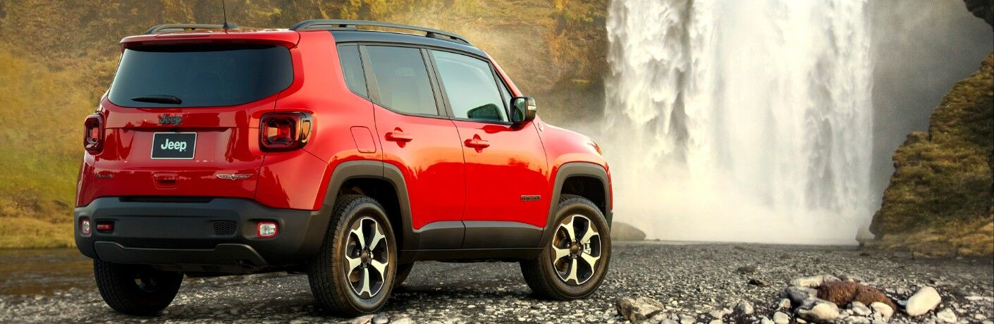 rear of red 2020 Jeep Renegade by waterfall