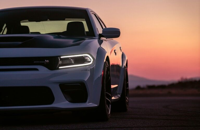 2020 dodge charger white facing shot cutoff sunset