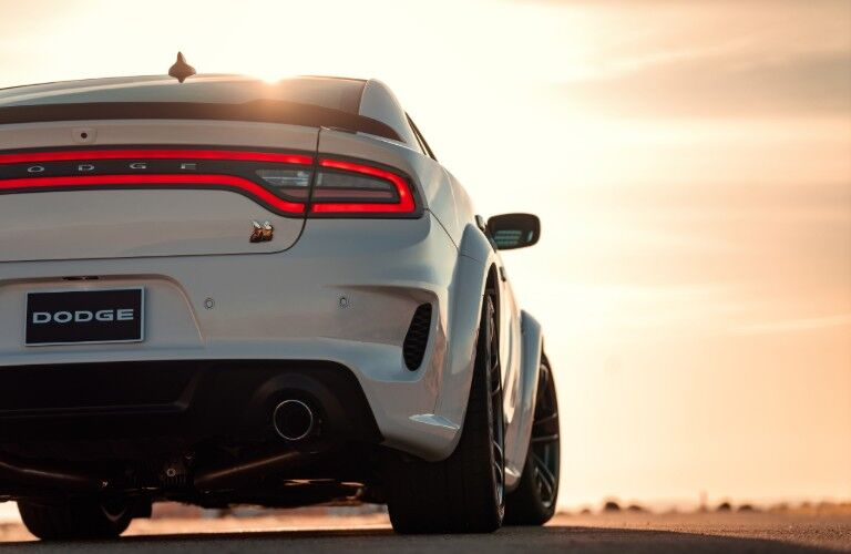 2020 Dodge Charger white facing away from shot view of back bumper