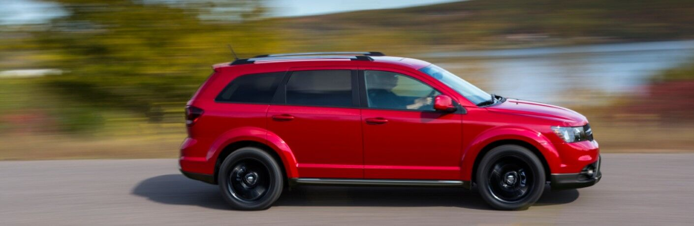red 2020 Dodge Journey driving on road