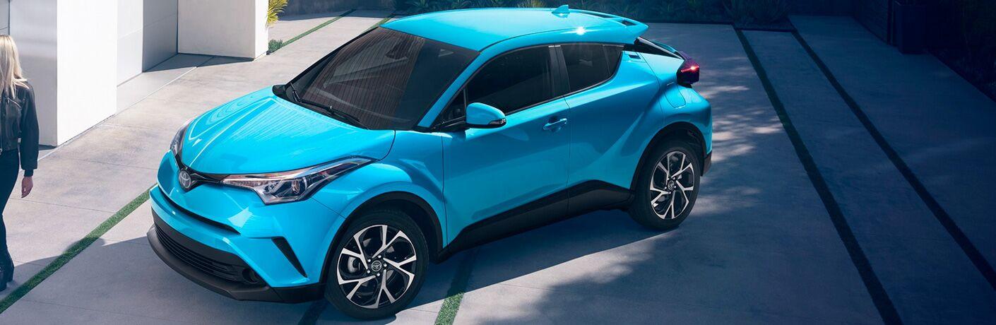 blue 2019 Toyota C-HR in driveway