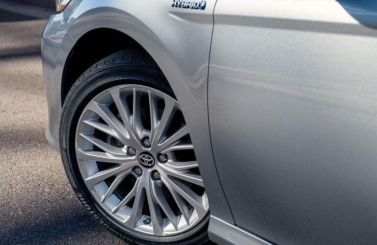 front left wheel of silver 2019 toyota camry hybrid