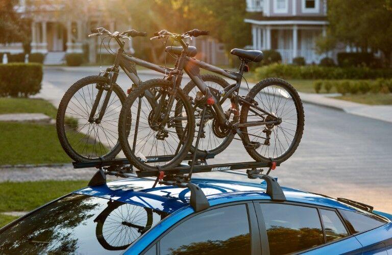 blue 2020 Toyota Prius with bikes on crossbars