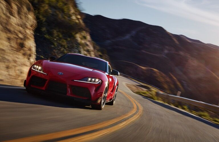red 2020 Toyota GR Supra driving down road
