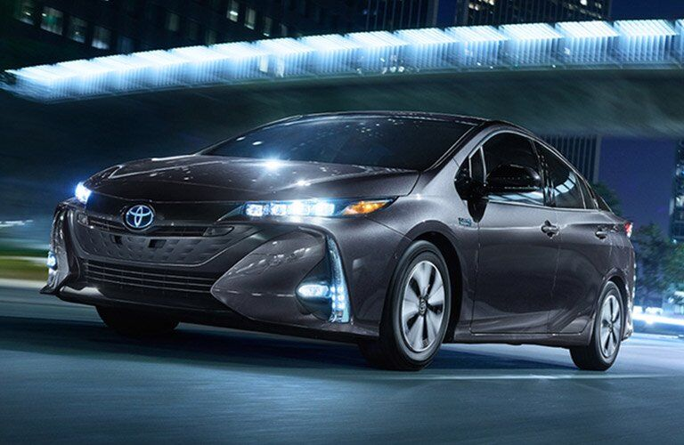 gray Toyota Prius Prime driving at night