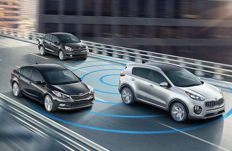 2018 Kia Sportage using radar and advanced safety feature to detect the Kia Sedans surrounding it