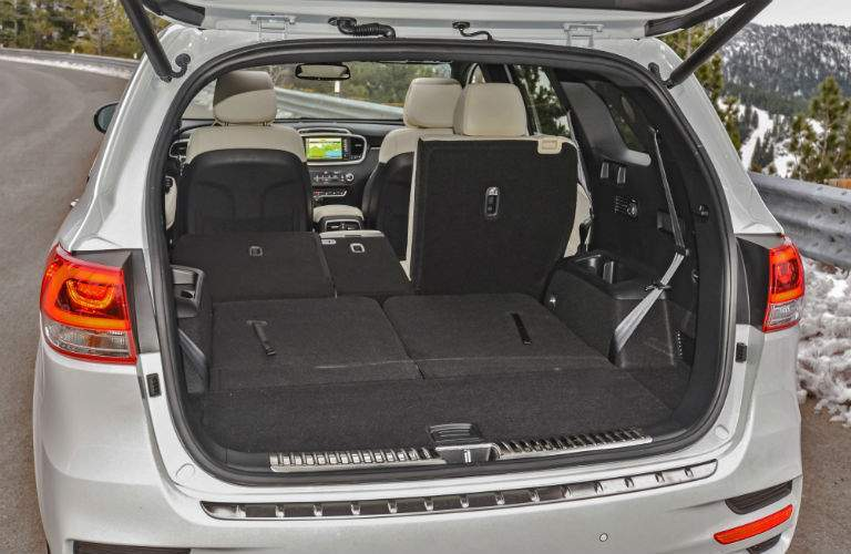 2018 Kia Sorento interior with rear seats folded down and the lift gate open