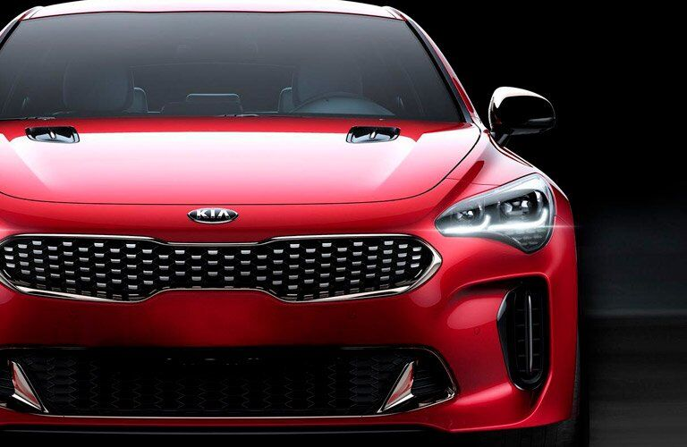 Front profile of the 2018 Kia Stinger parked in a black room