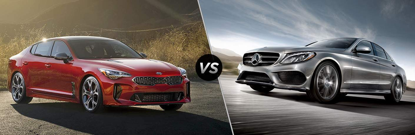 2018 Kia Stinger parked on concrete next to brush vs 2018 Mercedes-Benz C 300 driving on a highway