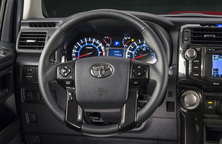An interior photo of the driver's cockpit in the 2019 Toyota 4Runner.