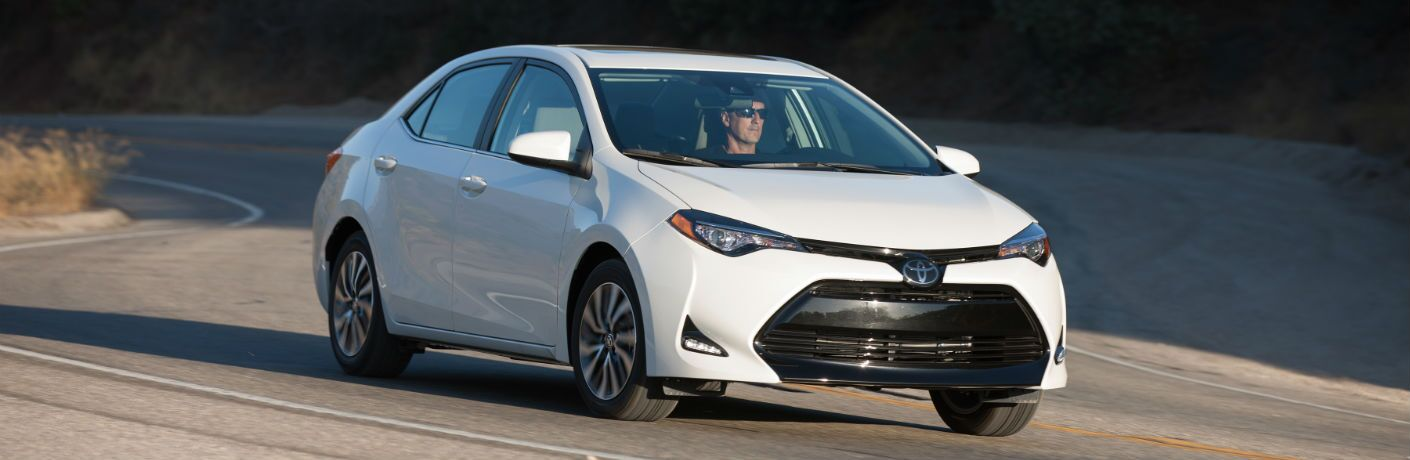 A front right quarter photo of the 2018 Toyota Corolla on the road.