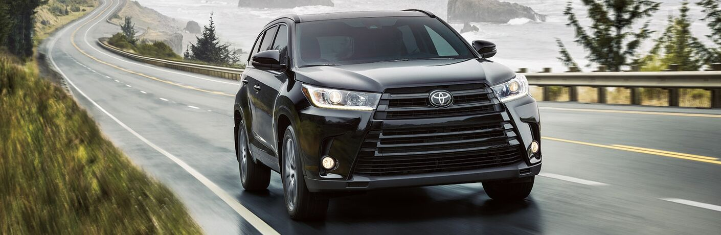 A head-on photo of the 2019 Toyota Highlander on the road.