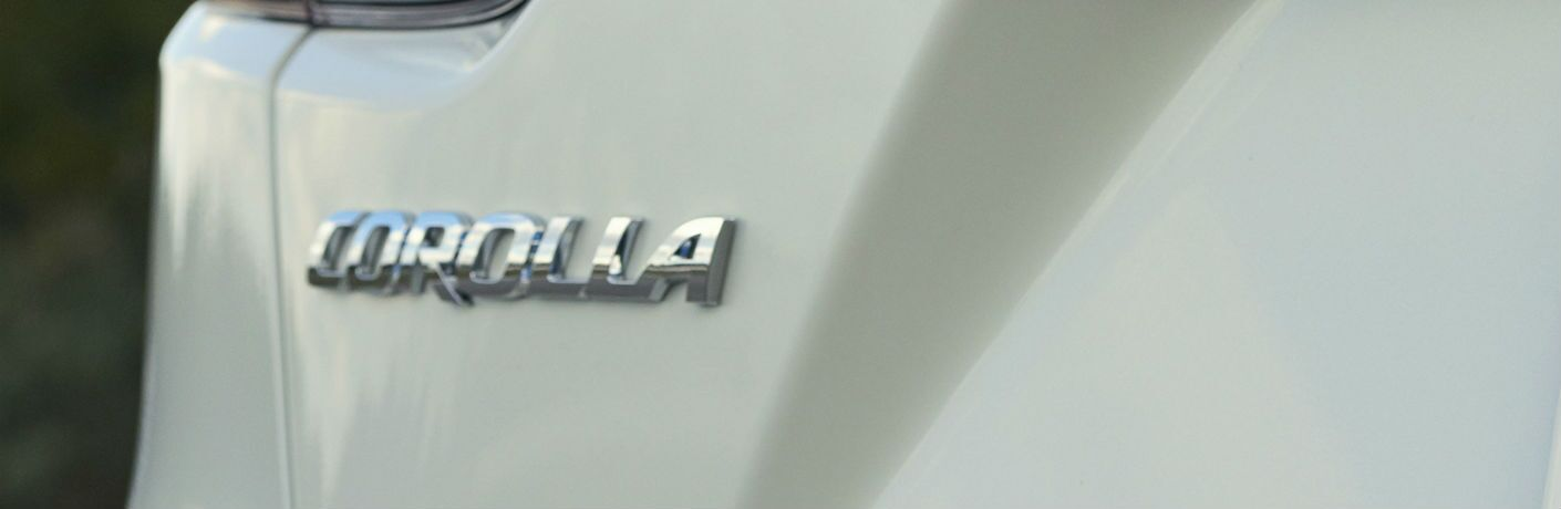 A close up of the Corolla badge worn by the 2020 Toyota Corolla.