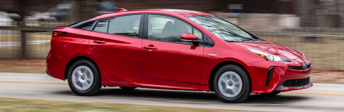 A right profile photo of the 2019 Toyota Prius in motion on the road.