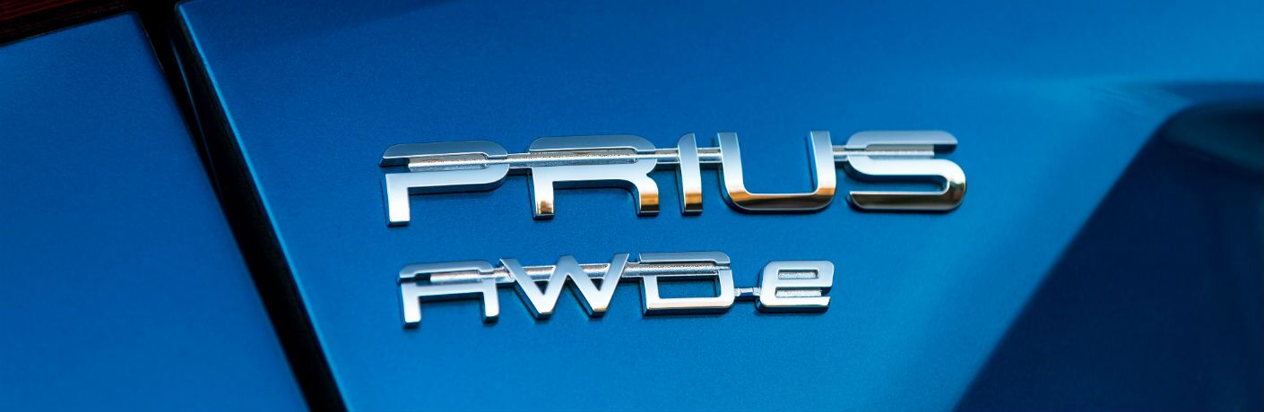 A close up photo of the Prius AWD-e badge used on the Toyota hybrid vehicle.