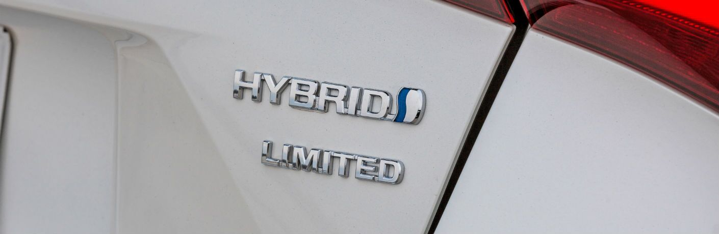 A photo of the hybrid badge worn on the 2019 Toyota Prius.