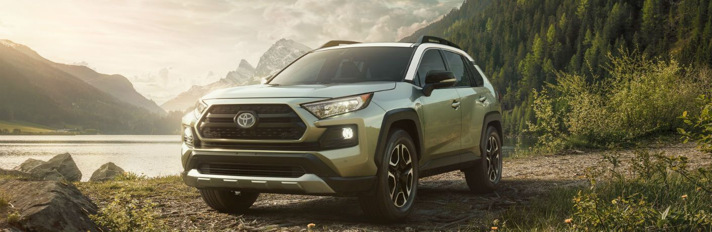 A front end photo of the 2019 Toyota RAV4 near a lake.