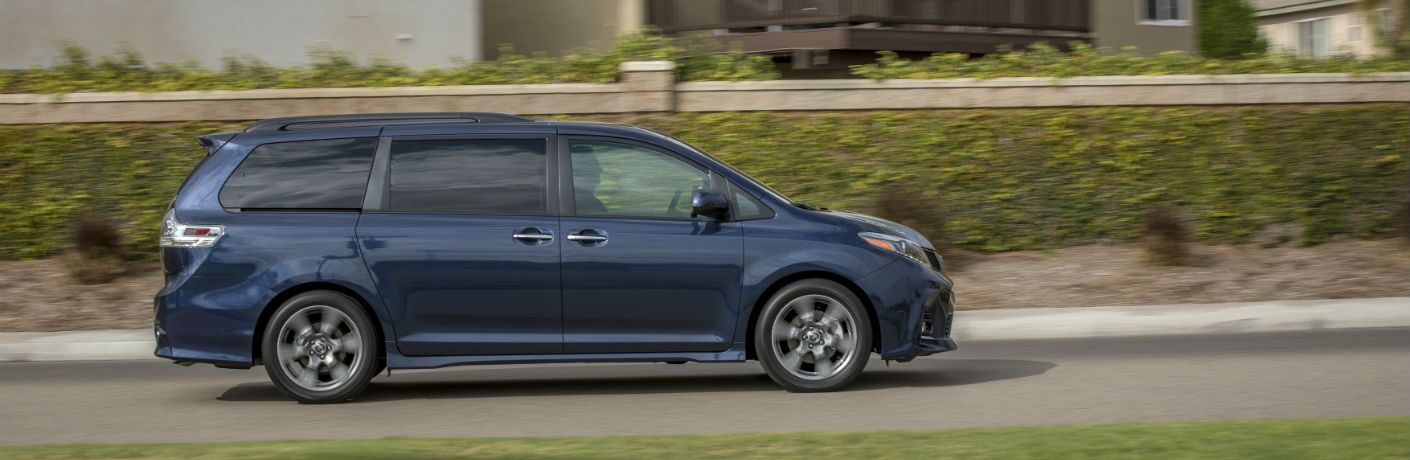 A right profile photo of the 2019 Toyota Sienna on the road.